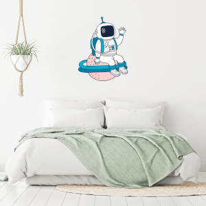 Astronaut Sitting On Planet Wall Art Sticker