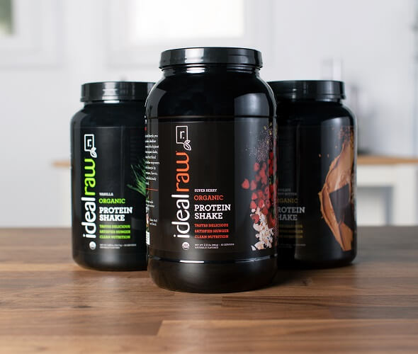 3 tubs of IdealRaw protein on a table