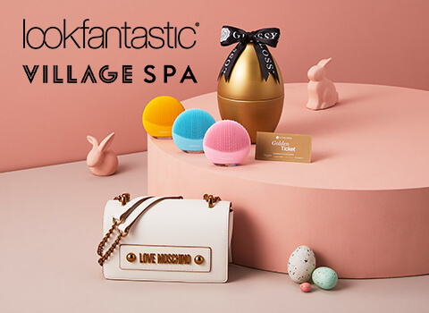 Golden Egg pictured with a Moschino Bag, Foreo Luna Mini's alongside the Lookfantastic and Village Hotels Logo