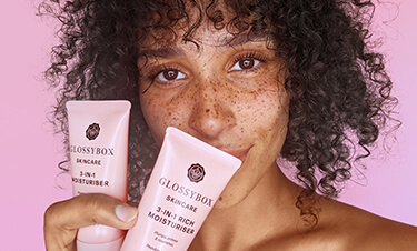model holding glossybox skincare products