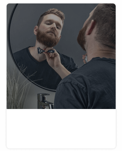 Bearded man shaving neck with King C. Gillette razor