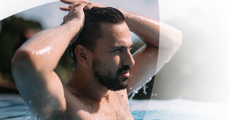 Man swimming, looking distressed.