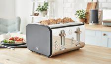 Silver Toaster on a wooden kitchen worktop