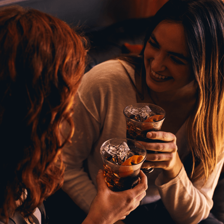 Two friends celebrating with an alcoholic drink