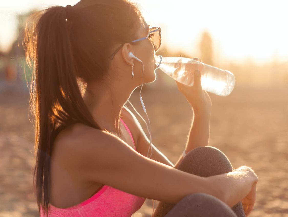 Woman enjoying a bottle of water on a run