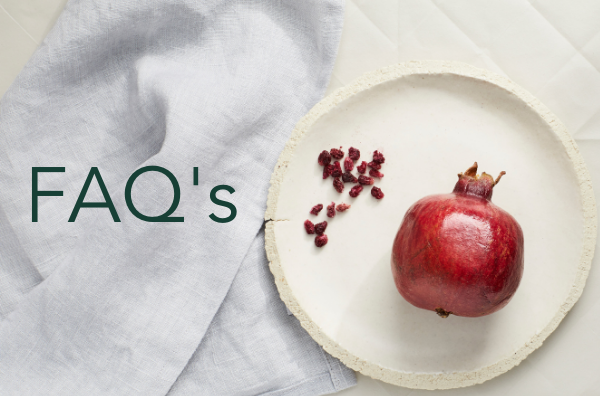 FAQ text on background banner image of pomegranate on plate with a white cloth