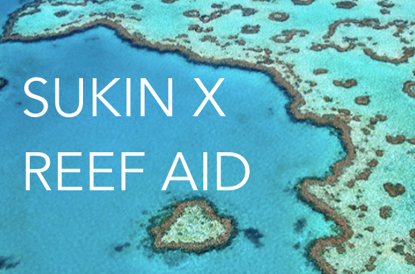 Sukin x Reef Aid text on reef sea background banner