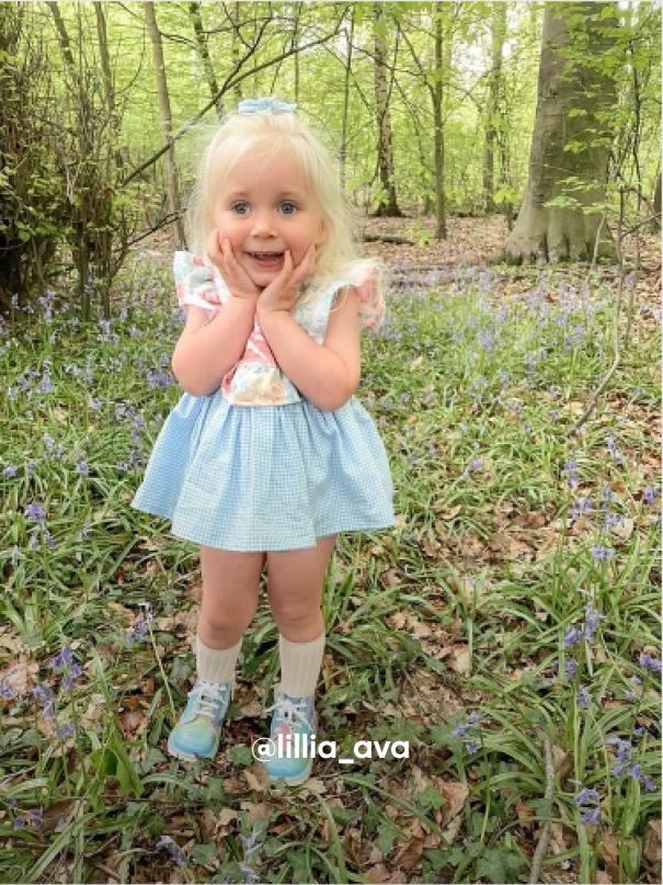 Girl Posing in the Grass - Visit Kickers Kids Instagram