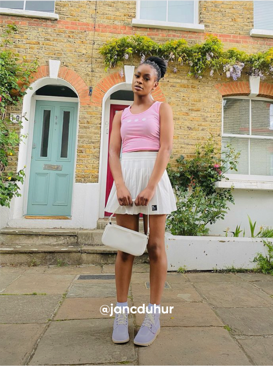 woman posting in front of her house - Visit Kickers Instagram