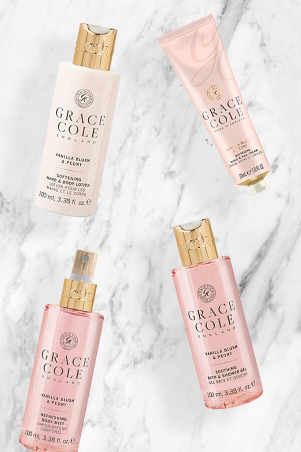 An image displaying 3 pink Grace Cole Products; three travel sets from the vanilla blush & peony range..